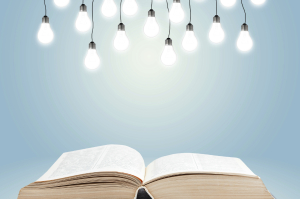 Open book with shining lamps